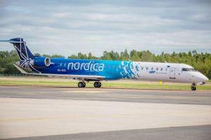 Hamburg – Tallinn im Streckenplan von Nordica Regional Jet